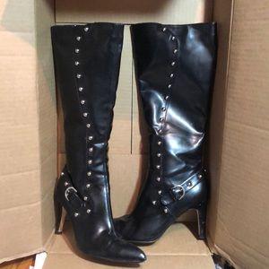 Long high heeled black boots